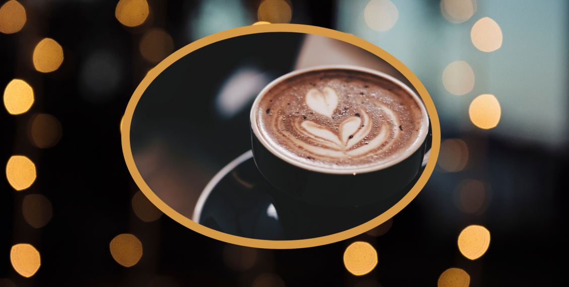 Latte art inside an oval with a background of out of focus gold dots